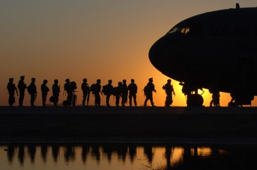 soldiers in line for airplane