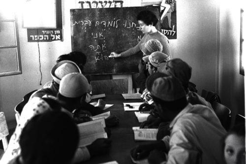 men learning from chalkboard