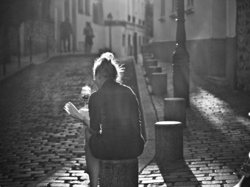 woman reading on street